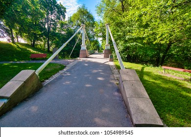 Aamodt bru is a suspension bridge located Oslo, Norway. It is a pedestrian bridge over the Aker River in the Oslo district of Grünerløkka