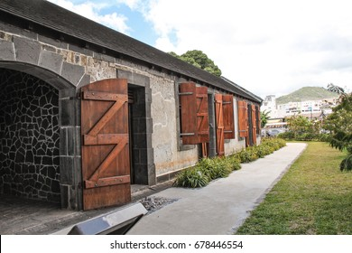 Aapravasi Ghat - World Heritage Site in Mauritius depicting the point in the once British Colony where indentured labor from India were brought to the island.