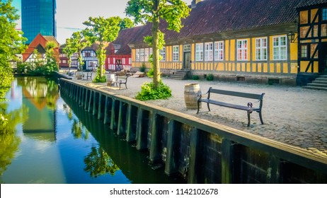 Aarhus, Denmark;  06 10 2016: The beautiful small river canal that flows through the Old Town, or Den Gamble By, an open-air town museum located in the Aarhus Botanical Gardens, Denmark, Scandinavia.