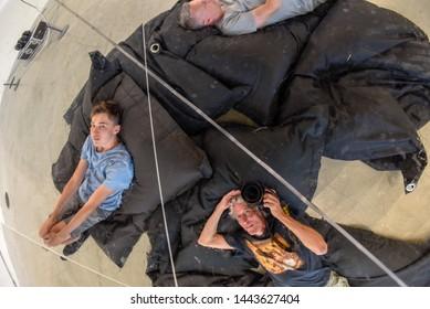 Aarhus, Denmark - 19 June 2019: people in front of an art installation of the ARoS art museum of Aarhus on Denmark