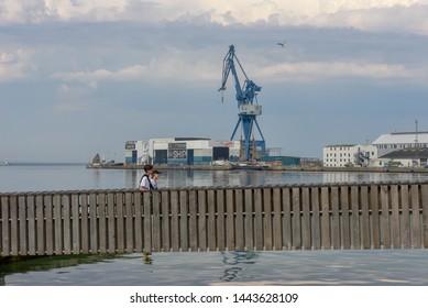 Aarhus, Denmark - 19 June 2019: people walking in front of the port of Aarhus in Denmark