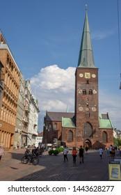 Aarhus, Denmark - 19 June 2019: people walking in front of 13th century Cathedral at Aarhus on Denmark