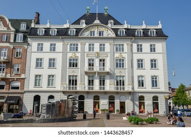 Aarhus, Denmark - 19 June 2019: people walking in front of an old traditional building at Aarhus in Denmark