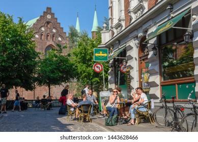 Aarhus, Denmark - 19 June 2019: people drinking on a street bar of Aarhus on Denmark