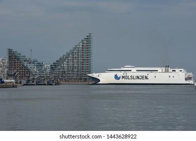 Aarhus, Denmark - 19 June 2019: ferry in front of modern residential neighborhood at Aarhus in Denmark