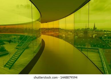 Aarhus, Denmark - 19 June 2019: people walking on the rainbow panorama of ARoS art museum at Aarhus on Denmark