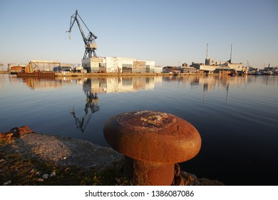 Aarhus / Denmark - April 21, 2019: Docklands harbor in the city center with a huge painting on the wall