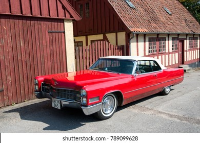 AARHUS, DENMARK - AUGUST 23: Vintage Cadillac in the Old Town on August 23, 2013 in Aarhus. This open air museum displays traditional Danish architecture from 16th century to 19th century.