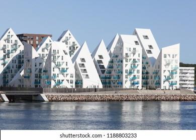 Aarhus, Denmark - August 26, 2018: Aarhus harbor and view of the Iceberg building from the sea in Aarhus, Denmark