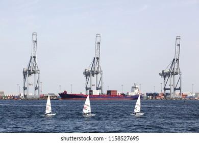 Aarhus, Denmark - August 7, 2018: Laser radial sailings ships in the harbor of Aarhus, Denmark