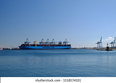 Aarhus, Denmark - circa august, 2019: Maersk line ship arriving in the city port of the second largest city of the country. Blue sky. Blue and bright sea's water.
