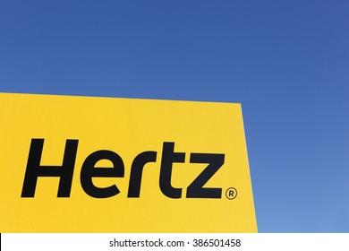 Aarhus, Denmark - February 13, 2016: Hertz logo on a panel. Hertz is an American car rental company with international locations in 145 countries worldwide