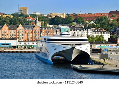 Aarhus, Denmark - July 20, 2017: The high-speed ferry EXPRESS 2 of the shipping company Molslinjen is moored at the pier in the port of Aarhus (Denmark).