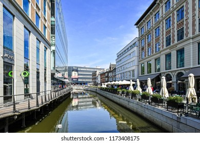 Aarhus, Denmark - July 20, 2017: Promenade along the river Å in downtown Aarhus in Denmark. The many restaurants, cafes and shops along the river attract both locals and tourists.