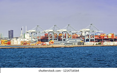 Aarhus, Denmark – July 20, 2017: The container ship MSC INGY has docked in the port of Aarhus (Denmark) and is loading and unloading.