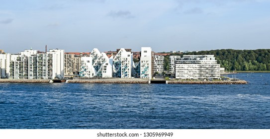 "Aarhus, Denmark - July 20, 2017: View from the sea side to the residential complex ""Isbjerget"" (Iceberg) in Aarhus, Denmark. It is belonging to a new district on the harbor area near the town center."