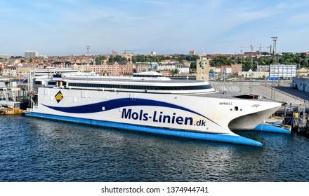Aarhus, Denmark - July 20, 2017: The high-speed ferry EXPRESS 1 of the shipping company Molslinjen is moored at the pier in the port of Aarhus (Denmark).