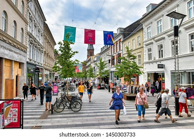 Aarhus, Denmark – July 20, 2017: People stroll along the shopping mile Ryesgade in the centre of the Danish town of Aarhus.  Ryesgade is one of Denmark's busiest commercial pedestrian zones.