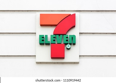 Aarhus, Denmark - July 6, 2017: 7 eleven logo on a wall. 7-Eleven is an international chain of convenience stores that operates primarily as a franchise