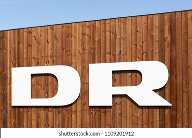Aarhus, Denmark - June 8, 2018: DR logo on a wall. Danmarks Radio, abbreviated DR is the danish public broadcasting company founded in 1925