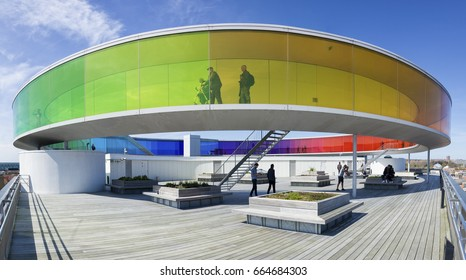 Aarhus, Denmark - May 2, 2017: Your Rainbow Panorama, an installation by Danish-Icelandic artist Olafur Eliasson. Visitors inside and on the patio below the artwork.