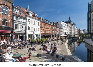 Aarhus, Denmark - May 22, 2017: Many people enjoying a sunny day at Aboulevard, the promenade along the river Aarhus A. Aarhus is the second largest city in Denmark.