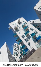 """Aarhus, Denmark - May 25, 2017: Oblique view of contemporary residential architecture at newly developed harbor area. The complex is called """"Isbjerget"""", which is Danish for """"Iceberg"""""""