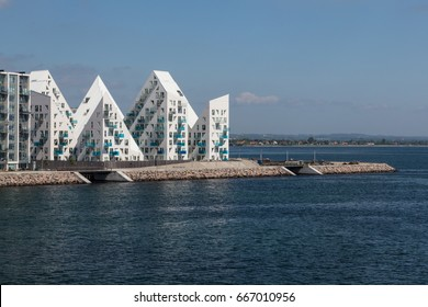 "Aarhus, Denmark - May 25, 2017: Contemporary residential architecture at newly developed harbor area. The complex is called ""Isbjerget"", which is Danish for ""Iceberg"" Sea View"