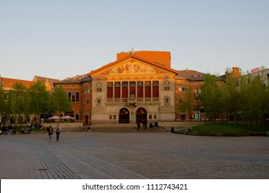 Aarhus / Denmark - May 9 2018: Colourful sunset picture of Aarhus Theatre on Bispetorvet square - the largest provincial theatre in Denmark.