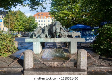 Aarhus, Denmark - September 7, 2019: The well of pigs was made by the sculptor Mogens and was donated to Aarhus in 1941 by the local brewery Ceres.