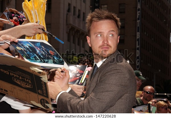 Aaron Paul at the Bryan Cranston Star on the Hollywood Walk of Fame Ceremony, Hollywood, CA 07-16-13
