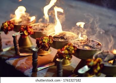 Aarti ceremony flowers with fire in Varanasi.