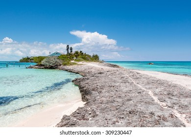 ABACO, BAHAMAS - MAY 22, 2015 - White sand, rocks and clear water on May 22, 2015 in Man O War Cay Abaco.