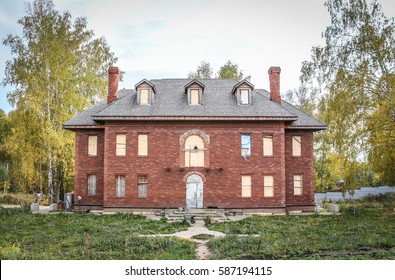 Abadoned country house with boarded up windows