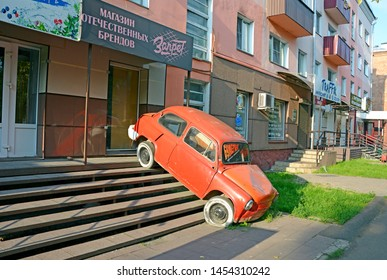 """Abakan, Russia 07.18.2019: Strange / incomprehensible ad comic book store. Old car is installed on the stairs leading to the store. The inscription on the glass of an old car: """"Comic Store"""""""