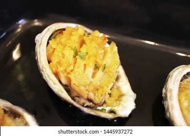 Abalone dish on plate. And abalone grilled.