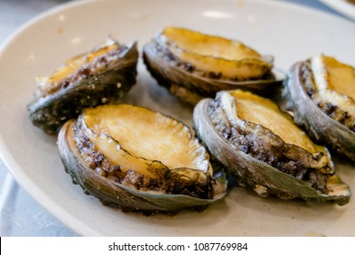 Abalone grilled. This menu use fresh seafood and it easy to find in Korea. And also not expensive.  Most of it found at fish market.