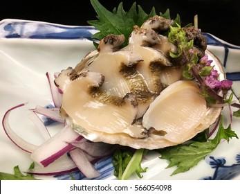 Abalone sashimi on black background