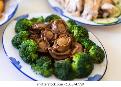 Abalones. Chinese cuisine Braised abalone with sauce.