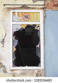 Abandoned 18+ shop window broken and ruin. For eighteen plus age only
