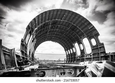 Abandoned Airplane,old crashed plane with cloudy sky,plane wreck tourist attraction,Old plane wreck