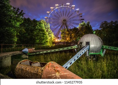 the abandoned amusement park at night