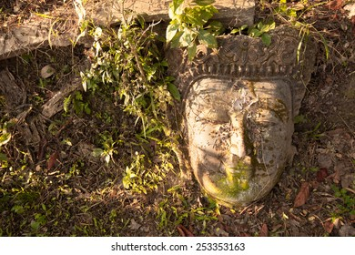 Abandoned antique face buddha.
