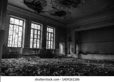 Abandoned assembly hall at the School, house of art. The concept of destruction and decline of culture and art. black and white