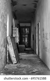 Abandoned Asylum hallway with dirty mattress and crumbly walls