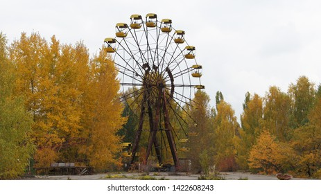Abandoned attraction Ferris wheel in an amusement park after the tragedy in Chernobyl, our days