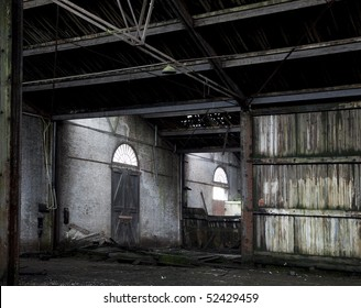Abandoned barn in the Antwerp harbor, with many original details still visible