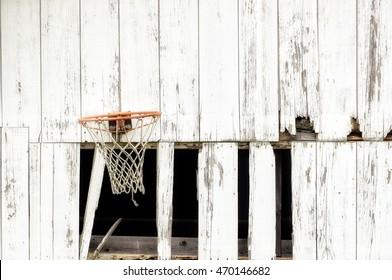 An Abandoned Barn with a Basketball Hoop