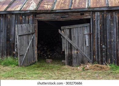 abandoned barn in a village with a rusty roof and wood inside