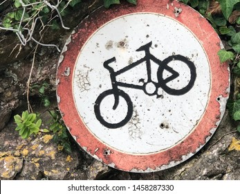Abandoned and battered bicycle sign